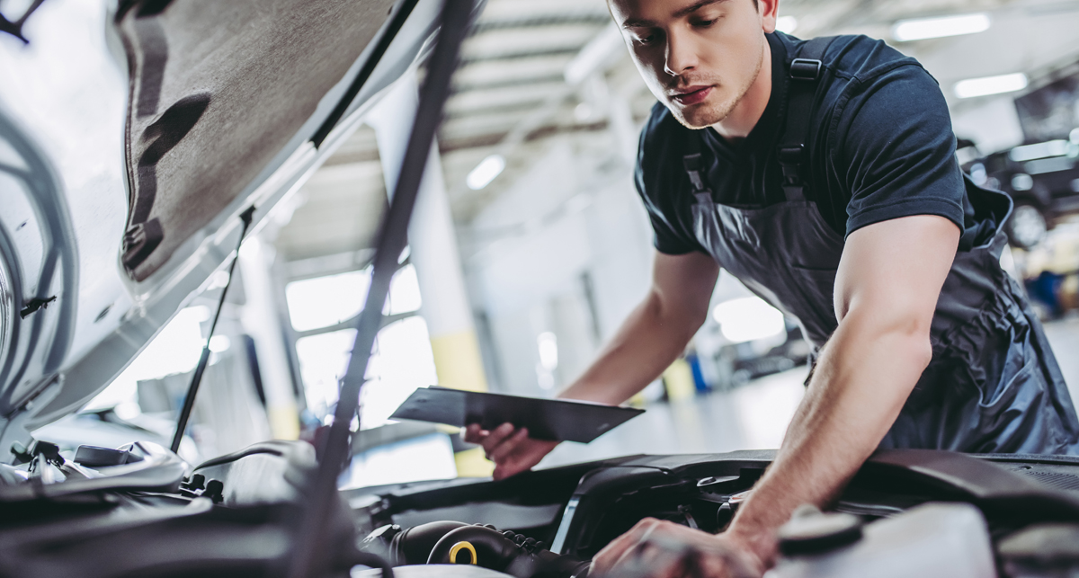 Technician servicing a car - Car Service Littleport - Book Online