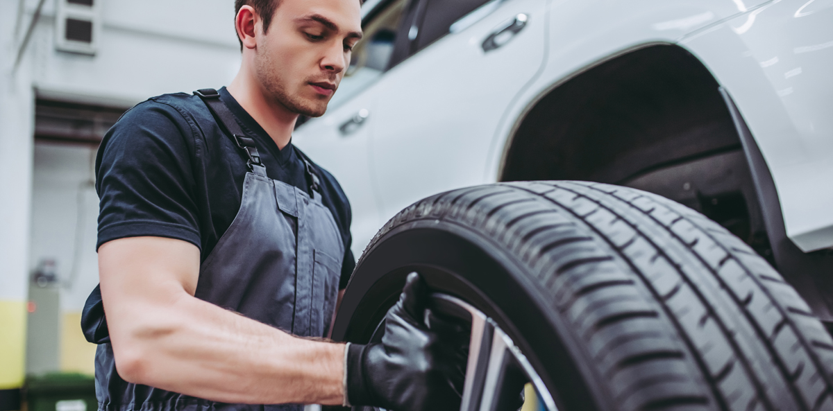 Mechanic fitting a tyre to a vehicle - Tyres Littleport - Book Tyres Online